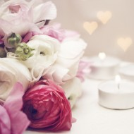 ranunculus with candles and romantic light